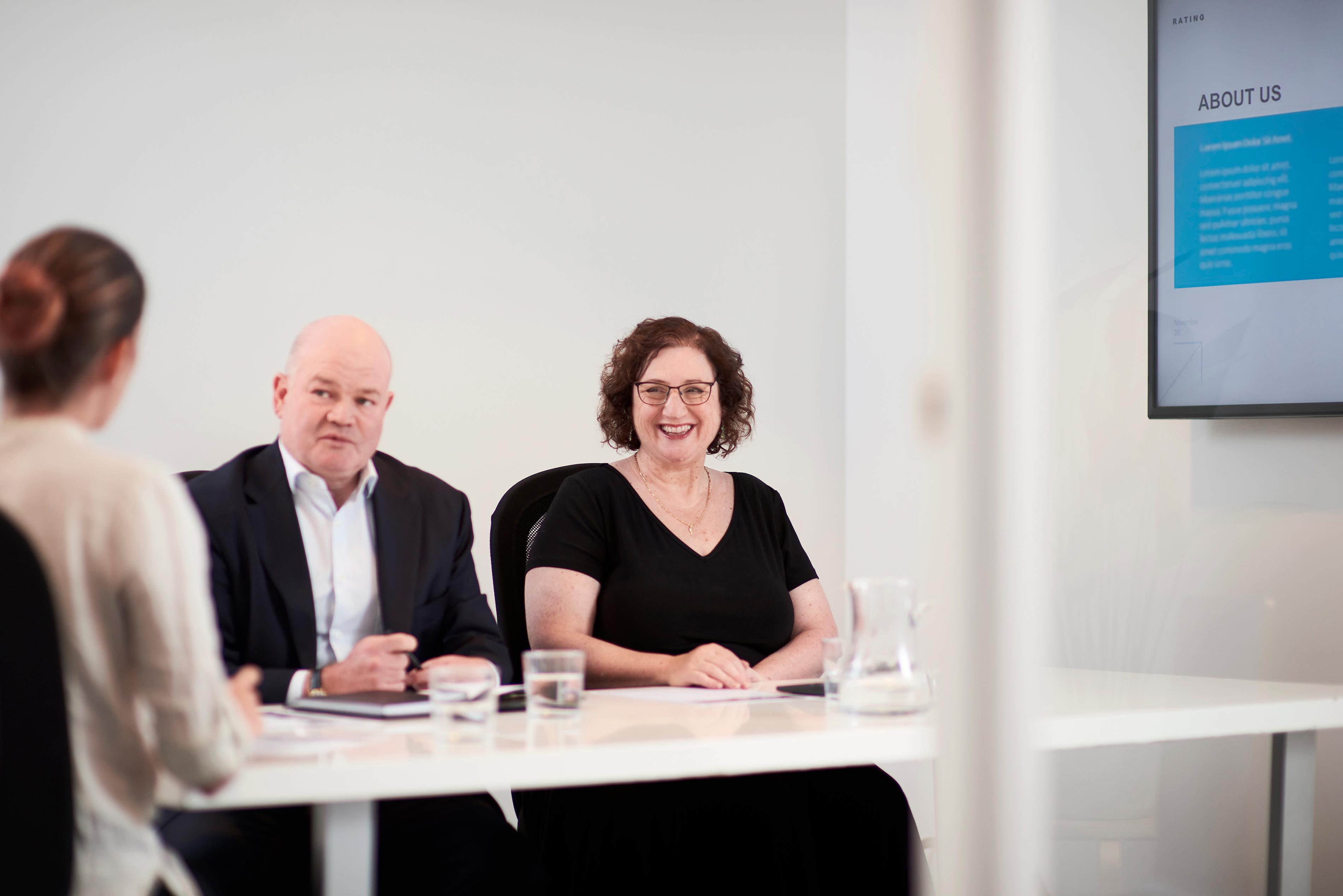 Image of David and Nadia Moffatt, owners of BONROS, while sitting in a meeting.